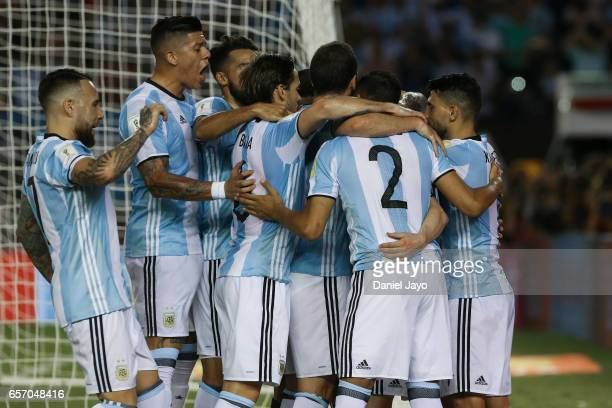 Lionel Messi of Argentina celebrates with teammates after scoring his team's first goal during a match between Argentina and Chile as part of FIFA...