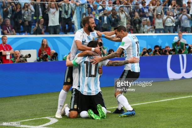 Lionel Messi of Argentina celebrates with teammates after scoring his team's first goal during the 2018 FIFA World Cup Russia group D match between...