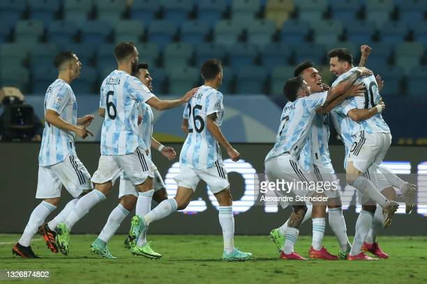 Lionel Messi of Argentina celebrates with teammates after scoring the third goal of his team via free kick during a quarter-final match of Copa...