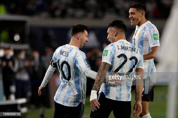 Lionel Messi of Argentina celebrates with teammates after scoring the opening goal during a match between Argentina and Bolivia as part of South...