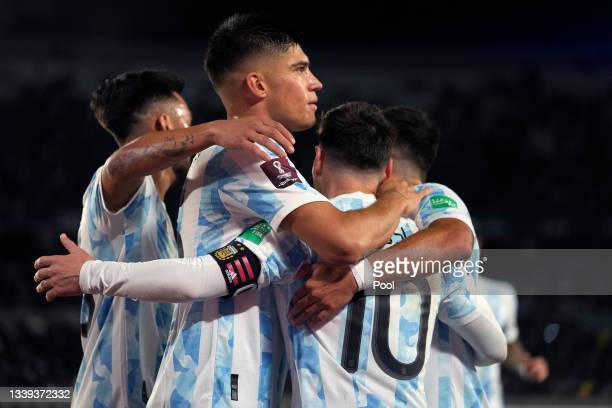 Lionel Messi of Argentina celebrates with teammates after scoring the third goal of his team during a match between Argentina and Bolivia as part of...