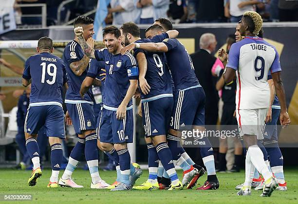 Lionel Messi of Argentina celebrates with teammates after scoring the second goal of his team during the Semifinal match between United States and...
