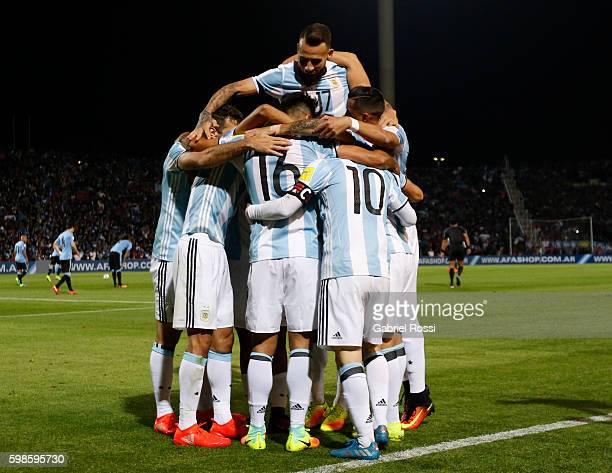 Lionel Messi of Argentina celebrates with teammates after scoring the first goal of his team during a match between Argentina and Uruguay as part of...