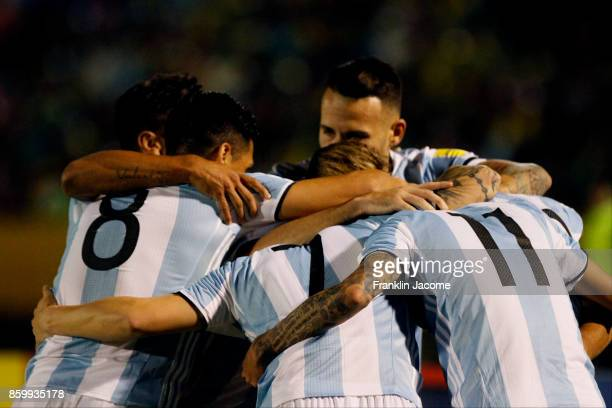 Lionel Messi of Argentina celebrates with teammates after scoring the second goal of his team during a match between Ecuador and Argentina as part of...
