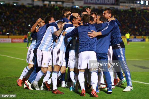Lionel Messi of Argentina celebrates with teammates after scoring the third goal of his team during a match between Ecuador and Argentina as part of...