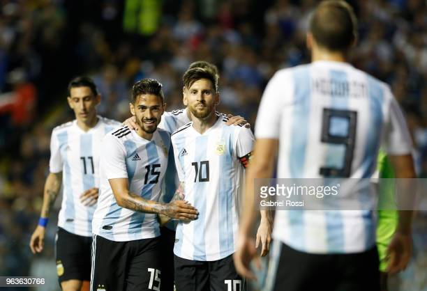 Lionel Messi of Argentina celebrates with teammates after scoring the second goal of his team during an international friendly match between...