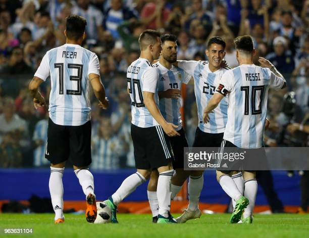 Lionel Messi of Argentina celebrates with teammates after scoring the third goal of his team during an international friendly match between Argentina...