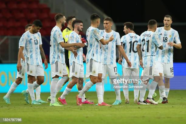 Lionel Messi of Argentina celebrates with teammates after winning a group A match between Argentina and Paraguay as part of Conmebol Copa America...