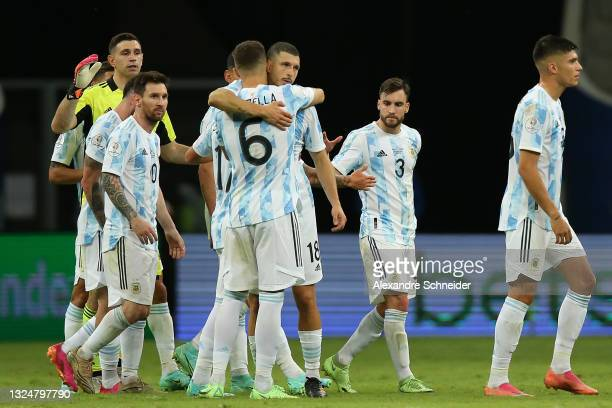 Lionel Messi of Argentina celebrates with teammates German Pezzella and Guido Rodriguez after winning a group A match between Argentina and Paraguay...
