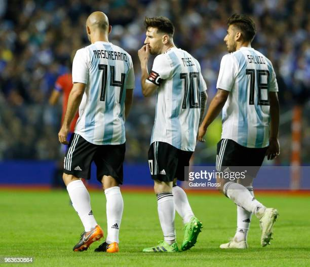 Lionel Messi of Argentina celebrates with teammates Javier Mascherano and Eduardo Salvio after scoring the second goal of his team during an...