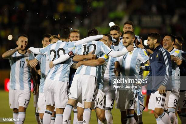 Lionel Messi of Argentina celebrates with teammates qualifying to the World Cup after winning a match between Ecuador and Argentina as part of FIFA...