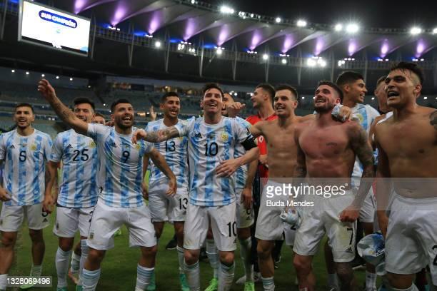 Lionel Messi of Argentina celebrates with teammates Sergio Agüero, Rodrigo De Paul and Lisandro Martinez after winning the final of Copa America...