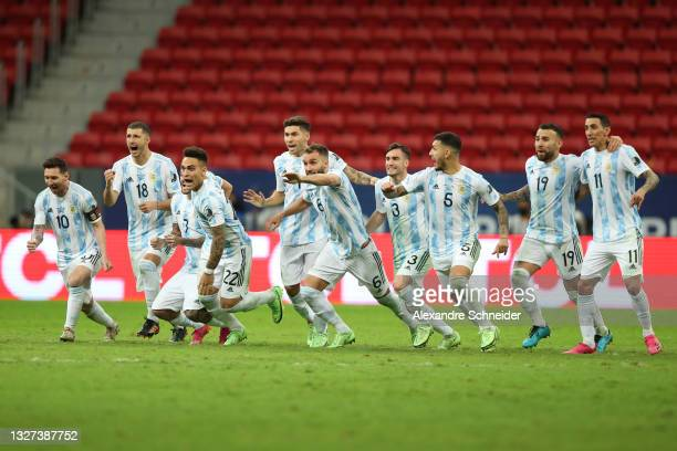 Lionel Messi of Argentina celebrates with teammates winning a penalty shootout after a semi-final match of Copa America Brazil 2021 between Argentina...