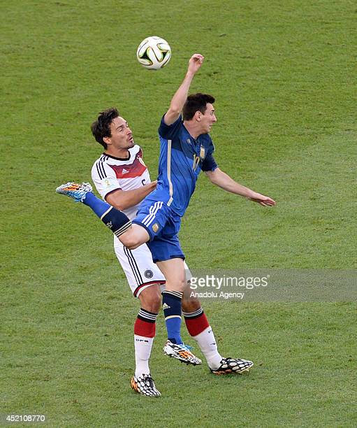 Lionel Messi of Argentina challenges with Mats Hummels of Germany during the final of the FIFA World Cup 2014 between Germany and Argentina at the...
