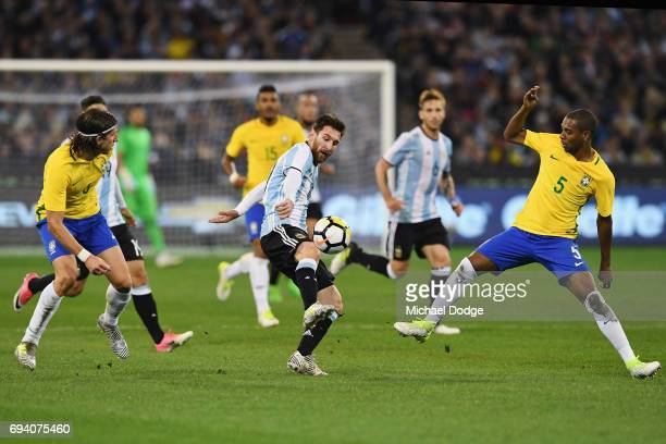 Lionel Messi of Argentina competes for the ball against Fernando Roza of Brazil during the Brasil Global Tour match between Brazil and Argentina at...