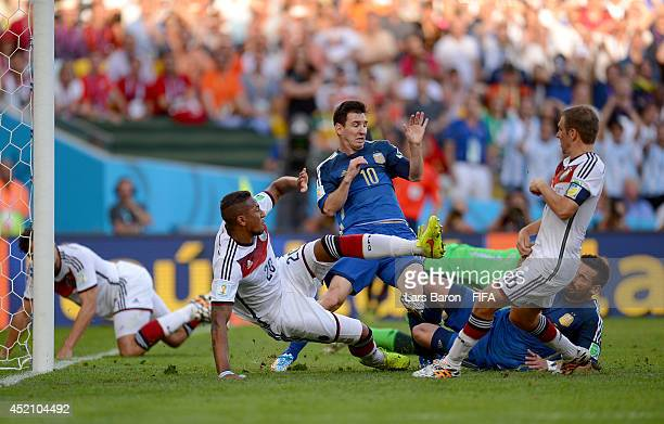 Lionel Messi of Argentina competes for the ball against Jerome Boateng and Philipp Lahm of Germany during the 2014 FIFA World Cup Brazil Final match...