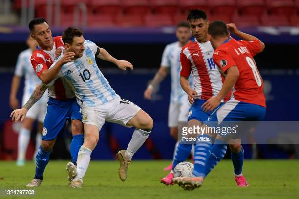 Lionel Messi of Argentina competes for the ball with Ángel Cardozo , Santiago Arzamendia and Richard Sanchez of Paraguay during a group A match...