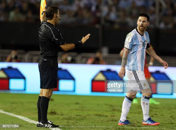 Lionel Messi of Argentina complains to a linesman during a match between Argentina and Chile as part of FIFA 2018 World Cup Qualifiers at Monumental...