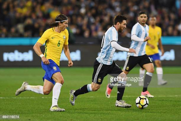 Lionel Messi of Argentina controls fo the ball against Filipe Luis of Brazil during the Brasil Global Tour match between Brazil and Argentina at...