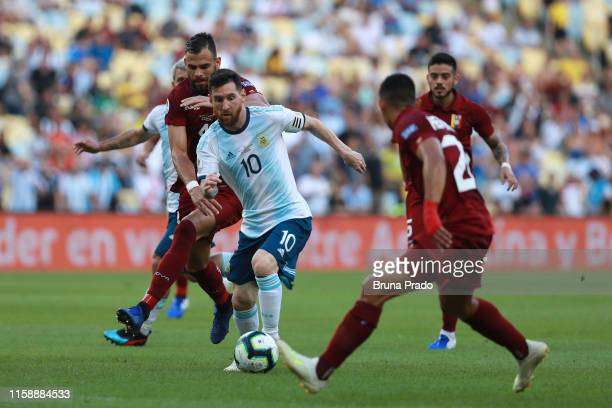 Lionel Messi of Argentina controls the ball against Jhon Chancellor of Venezuela during the Copa America Brazil 2019 quarterfinal match between...