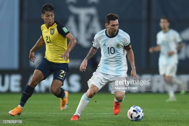 Lionel Messi of Argentina controls the ball against Moises Caicedo of Ecuador during a match between Argentina and Ecuador as part of South American...