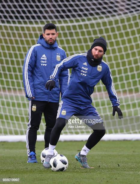Lionel Messi of Argentina controls the ball as Sergio Aguero looks on during a Argentina training session at Manchester City Football Academy on...