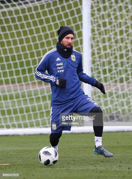Lionel Messi of Argentina controls the ball during a Argentina training session at Manchester City Football Academy on March 20 2018 in Manchester...