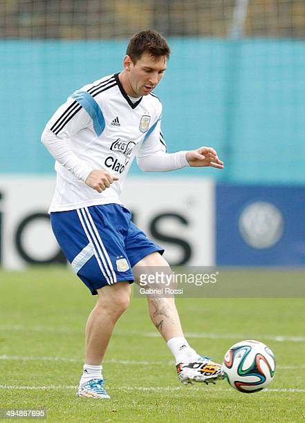 Lionel Messi of Argentina controls the ball during an Argentina training session at Ezeiza Training Camp on May 31 2014 in Ezeiza Argentina