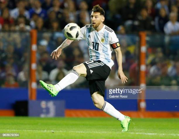 Lionel Messi of Argentina controls the ball during an international friendly match between Argentina and Haiti at Alberto J Armando Stadium on May 29...