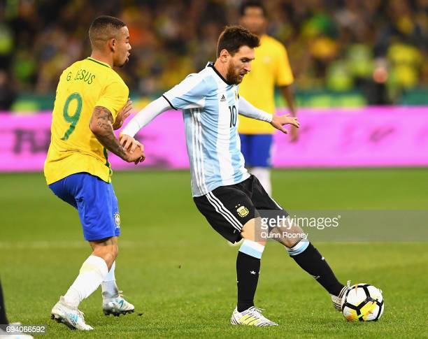 Lionel Messi of Argentina controls the ball infront of Jesus Gabriel of Brazil during the Brazil Global Tour match between Brazil and Argentina at...
