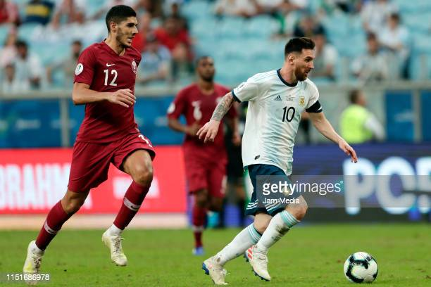 Lionel Messi of Argentina controls the ball under pressure from Karim Boudiaf of Qatar during the Copa America Brazil 2019 group B match between...