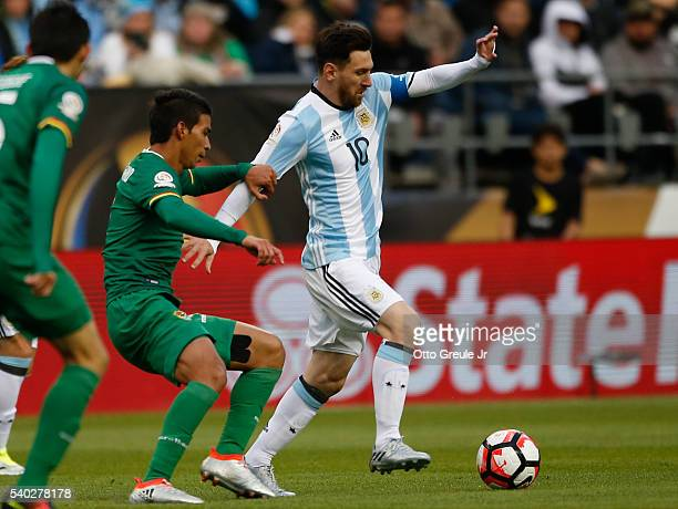 Lionel Messi of Argentina dribbles against Danny Bejarano of Bolivia during the 2016 Copa America Centenario Group D match at CenturyLink Field on...