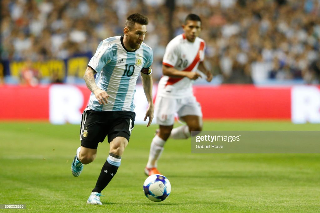 Lionel Messi of Argentina drives the ball during a match between Argentina and Peru as part of FIFA 2018 World Cup Qualifiers at Estadio Alberto J. Armando on October 5, 2017 in Buenos Aires, Argentina.