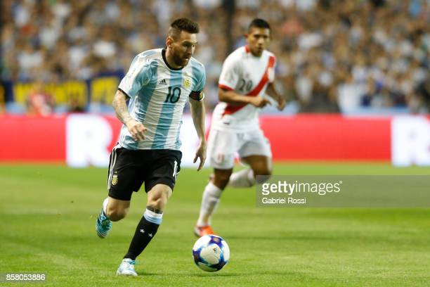 Lionel Messi of Argentina drives the ball during a match between Argentina and Peru as part of FIFA 2018 World Cup Qualifiers at Estadio Alberto J...