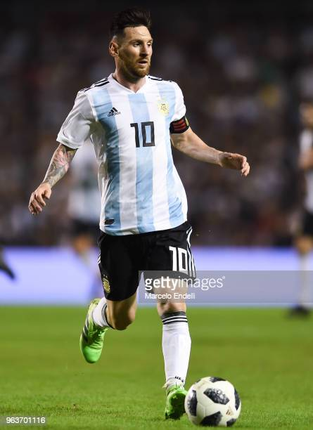 Lionel Messi of Argentina drives the ball during an international friendly match between Argentina and Haiti at Alberto J Armando Stadium on May 29...
