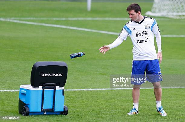 89e3bd8e64 Lionel Messi of Argentina drops a Powerade bottle during a training session  at Cidade do Galo