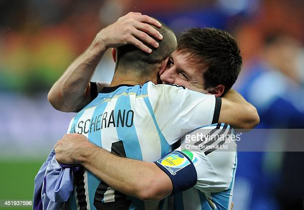 Lionel Messi of Argentina embraces team-mate Javier Mascherano at full-time following the 2014 FIFA World Cup Brazil Semi Final match between...