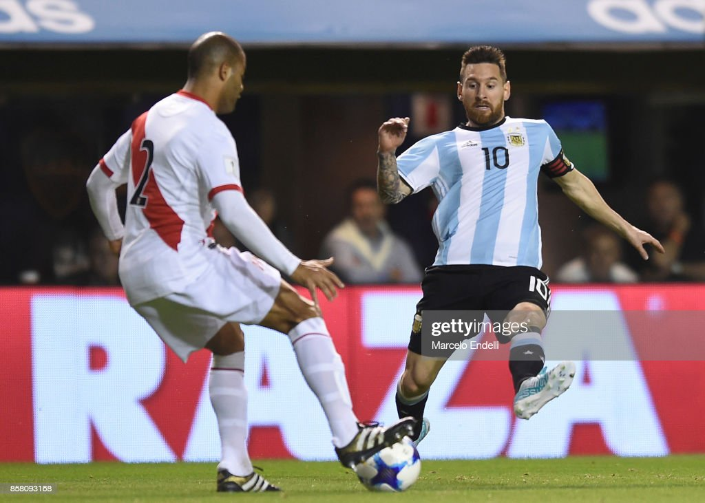 Lionel Messi of Argentina fights for ball with Alberto Valdeomar of Peru during a match between Argentina and Peru as part of FIFA 2018 World Cup Qualifiers at Estadio Alberto J. Armando on October 5, 2017 in Buenos Aires, Argentina.