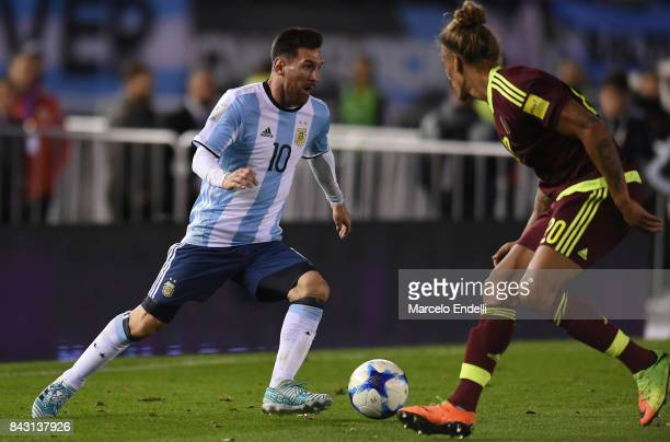 Lionel Messi of Argentina fights for ball with Rolf Feltscher of Venezuela during a match between Argentina and Venezuela as part of FIFA 2018 World...