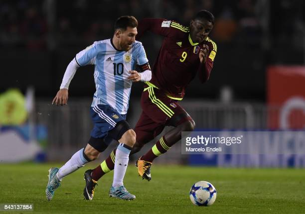 Lionel Messi of Argentina fights for ball with Sergio Cordova of Venezuela during a match between Argentina and Venezuela as part of FIFA 2018 World...