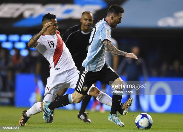 Lionel Messi of Argentina fights for ball with Victor Flores of Peru during a match between Argentina and Peru as part of FIFA 2018 World Cup...
