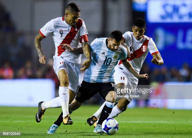 Lionel Messi of Argentina fights for ball with Wilder Cartagena and Paolo Guerrero of Peru during a match between Argentina and Peru as part of FIFA...