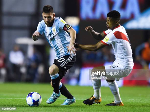 Lionel Messi of Argentina fights for ball with Wilder Cartagena of Peru during a match between Argentina and Peru as part of FIFA 2018 World Cup...