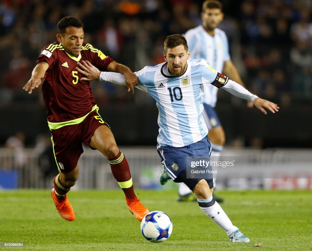 Lionel Messi of Argentina fights for the ball with Arquimedes Figuera of Venezuela during a match between Argentina and Venezuela as part of FIFA 2018 World Cup Qualifiers at Monumental Stadium on September 05, 2017 in Buenos Aires, Argentina.