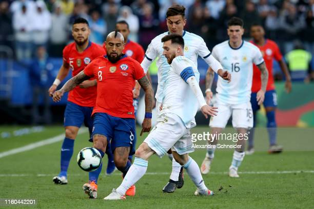 Lionel Messi of Argentina fights for the ball with Arturo Vidal of Chile during the Copa America Brazil 2019 Third Place match between Argentina and...