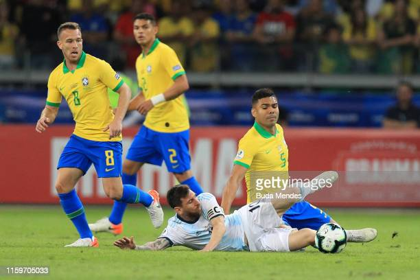 Lionel Messi of Argentina fights for the ball with Casemiro of Brazil during the Copa America Brazil 2019 Semi Final match between Brazil and...