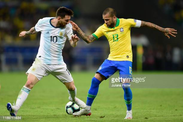 Lionel Messi of Argentina fights for the ball with Dani Alves of Brazil during the Copa America Brazil 2019 Semi Final match between Brazil and...