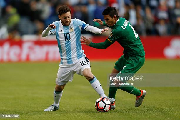 Lionel Messi of Argentina fights for the ball with Diego Bejarano of Bolivia during a group D match between Argentina and Bolivia at Century Link...