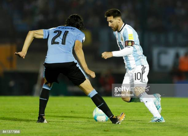 Lionel Messi of Argentina fights for the ball with Edinson Cavani of Uruguay during a match between Uruguay and Argentina as part of FIFA 2018 World...