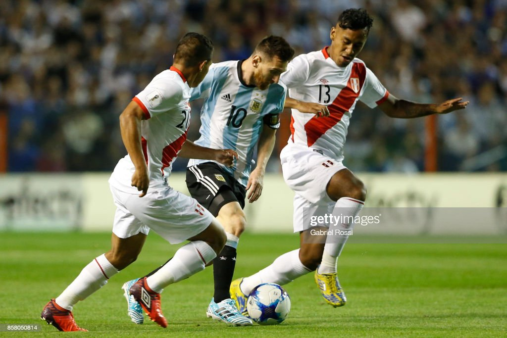 Lionel Messi of Argentina fights for the ball with Edison Flores of Peru and Renato Tapia of Peru during a match between Argentina and Peru as part of FIFA 2018 World Cup Qualifiers at Estadio Alberto J. Armando on October 5, 2017 in Buenos Aires, Argentina.